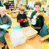 "1/24/97 School Reportcard 6 - James Neiss Photo - L-R - Lewport North Elementary Students Lee Wilks 8/3, Brian Seguin 8/3, Alex Ruckh 9/3 and christina Fuller 8/3 do a math project for ""Measure and Volume""."