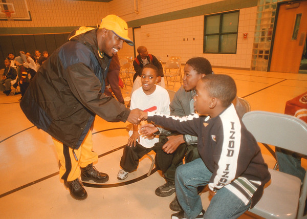 98/02/18 Entrepreneurship - James Neiss Photo - Mike Lewis of NF, AKA: DJ Hooker of WBLK greets excited fans L-R, Lametrius Gibson 11yrs of 9th st., Jermaine Ellison 12yrs of Grove Ave and Craig Copney 10 of 9th st.   DJ Hooker was the Featured speaker at the kick off meeting of the After School Entrepreneurship Program at the Niagara Falls Housing Authority Family Resource Building.