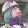 1/17/97 workers --Takaaki Iwabu photo-- Glen Sears of Iron Workers Local 9 bundles up as he works on construction (in front of Rainbow Bridge) Friday. Cold temparature makes his breath is visible as he communicates with another worker on the roof.                   1A, color