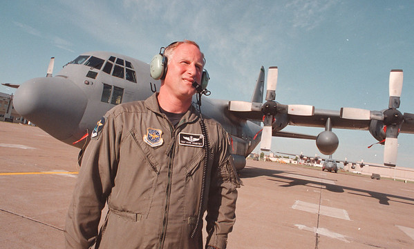 6/24/97--AIR SHOW/DEMBITSKY--DAN CAPPELLAZZO PHOTO--TECH SGT. MARK DEMBITSKY STANDS IN FRONT OF A C-130H3 CARGO PLANE ON THE TARMAC OF THE NF AIRBASE.<br /> <br /> ECHO
