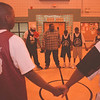 2/13/97--CHURCH BASKETBALL LEAGUE--DAN CAPPELLAZZO PHOTO--ASSISTANT ATHLETIC COORDINATOR HOMER BURNETT JR LEADS THE MT. SINAI TEAM AND THE TRINITY TEAM IN PRAYER BEFORE THE GAME AT THE  NF HOUSING AUTH. RESOURCE CENTER, 3001 9TH STREET.<br /> <br /> 1A SAT