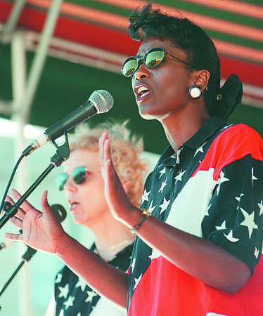 7/19/97--GOSPEL FEST.--DAN CAPPELLAZZO PHOTO--JOYCE HAMILTON (FRONT) AND LINDA WIRTH, OF VICTORY CHRISTIAN CENTER WORSHIP BELT OUT A GOSPEL TUNE FOR A CROWD AT LACKEY PLAZA.