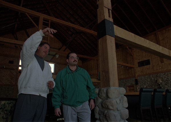 4/10/97-- Tan Tara Golf--Takaaki Iwabu photo-- R. Edward Groff, , left, food and beverage director of Tan Tara Golf Club, shows the renovated club house to Robert Bochiechio DDS, member of the Club. The new dining will be open to the public 29th of April. <br /> <br /> money, Saturday, bw