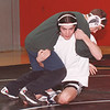 "2/13/97--AOW/DAVE DIXON ACTION--DAN CAPPELLAZZO PHOTO--NW WRESTLER DAVE DIXON EXECUTES THE ""FIREMAN'S CARRY"" ON A TEAMATE DURING A RECNT WORKOUT.<br />  <br /> <br /> SP"