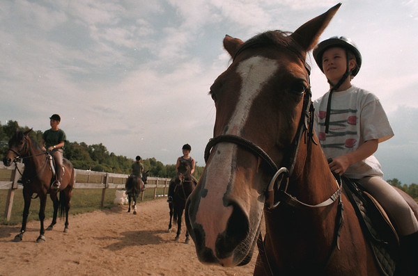 98/09/03--9/14/HORSES3--DAN CAPPELLAZZO PHOTO--10-YR-OLD MACKEY SNYDER, OF WILSON, SITS HIGH ON HER HORSE ABBY A 14-YR-OLD QUARTER HORSE.