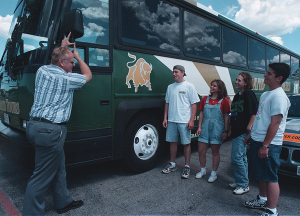 7/29/97-- driver education--Takaaki Iwabu photo-- Dr. Robert Franke, left, shows the blind spot from a bus-driver's seat while driving education class at Niagara Wheatfield High School. Listening to him are 11th graders, from left, Jake Edwards, Lisa Geraci, Jessica Eastman and Dan Haick. <br /> <br /> tmc photo