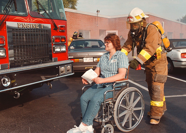 """97/10/13-- evacuation --Takaaki Iwabu photo-- Fire fighters from Lewiston Fire Co. No. 1 evacuate the """"mock"""" residents during the evacuation training at Fairchild manor Nursing Home. <br /> <br /> tmc photo"""