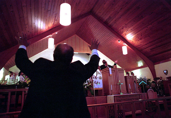 "4/22/97--BAPTIST CHURCH--DAN CAPPELLAZZO PHOTO--HERMAN ""CHUCK"" BOYER JR. PARISHINER AT ST. JOHN'S AME CHURCH PRAYS AS PASTOR TREVON D. GROSS SR. LEADS THE CENTER STREET BAPTIST CHRUCH IN PAYER.<br /> <br /> GRAPEVINE"
