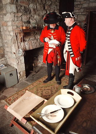 6/1/97--FT. NIAGARA 3--DAN CAPPELLAZZO PHOTO--(LTOR) GARRISON COMMANDER OF THE 64TH REGIMENT JAMES CORBETT AND SGT. JOE BLANCHARD GO OVER PAPERS IN THE OFFICERS QUARTERS. DURING THE ROYAL BIRTHDAY CELEBRATION.<br /> <br /> LOCAL