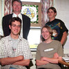 98/04/28 Stain Glass 2-Rachel Naber Photo-(clockwise from bottom left) Keith Cook,Dennis Kenney, jason Hucknall, Duane DeRoller made the stained glass piece that hangs in the window behind them.