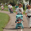 9/14/97--AIDS WALK--DAN CAPPELLAZZO PHOTO--AMY ZBIESZKOWSKI, OF NT, WALKS ON GOAT ISLAND WITH HER 6 MONTH-OLD SON MASON CANCILLA AND HER MOTHER SANDY STACHOWSKI, THEY ARE WEARING SHIRTS WITH A Photo OF SANDY'S HUSBAND/AMYS FATHER DAVID SHEFFER WHO DIED OF AIDS 4 YRS AGO.