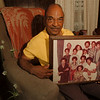 98/06/12 - father's day 2--Takaaki Iwabu photo-- Paul Lowery of 1765 Tennesee Ave. holds a picture of his 11 children. All except three stay in Western New York. (He got 36 grandchildren, 8 great grandchildren)   color, Feature, Sunday