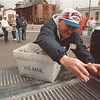 5/10/97-- food drive-- Takaaki Iwabu photo-- Jesse McGee of First Buptist Church loads the truck with donated food that  mail carriers collected Saturday. (Area volunteers and US postal workers collected thousands of bags of food from NF residents.)