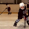 98/11/07 Hockey Outlet2-Rachel Naber Photo-Nick Maggi practices a backward skate with his teammates at the Hockey Outlet.