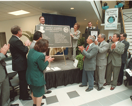 5/30/97 Water Plant 2 - James Neiss Photo - Mayor James Galie and Donna O'Laughlin unveil the plaque for the New Michael C. O'Laughlin Municipal Plant.