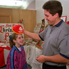 98/12/03 Christmas Memorabilia *Dennis Stierer Photo<br /> Ken McPherson kids with his daughter Alyssa, 9 at The Personal Touch, where he has a display of some very interesting and historic Christmas memorabilia.