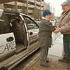 98/01/23--care express --Takaaki Iwabu photo-- Wayne Becher, right, a driver for Care Express gives a helping hand to one of many patients who use this transportation servis to Memorial Medical Center. <br /> <br /> 1A, color, Saturday