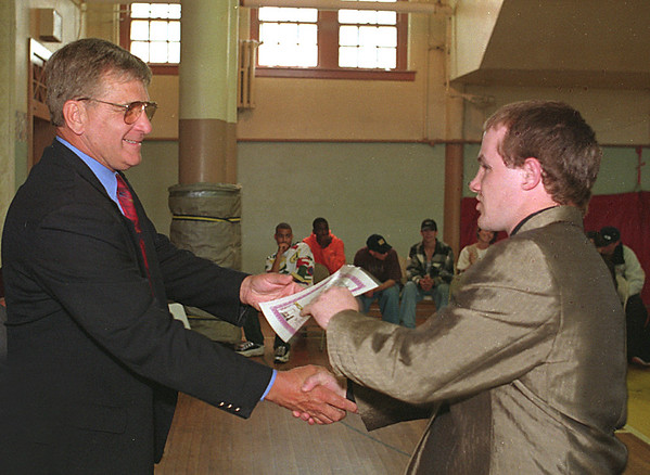 98/06/05 Achievement Award *Dennis Stierer Photo - David Sawyer, Principal at Lockport  Opportunities, congratulates Curtis Rahill on receiving his Achievement Award during ceremonies on Friday, Jun 6th.