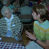 98/05/12 High School Seniors *Dennis Stierer Photo - Josephine Covis listens to Jen Wells , a 12th grader at Albion High School talk about how school is today. Senior Citizens from the Albion area visited the High School to see how school has changed since they went.<br /> <br /> MEDINA COLOR PHOTO