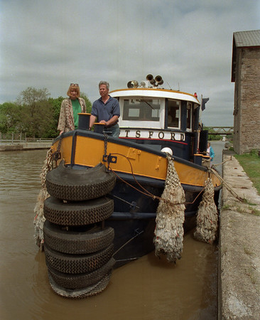 98/05/09 Canal Celebration *Dennis Stierer Photo - Deb and Paul Drinkwalter of Lockport check out the tug Pittsford, built in 1949 that was docked at Mike Murphy's Lockport Canal Tours site as part of the Canal Heritage Celebration.