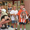 "98/07/29 Monkey Business *Dennis Stierer Photo -<br /> Carmen Prestio, a handler with Monkey Business, the  primate rehabilitation center in Niagara Falls brought some monkey's down to Roy B. Kelly school to see some kids. He's holding ""Saro"", a Cebus Capuchin monkey as the children look on. They are: from the left:  Jonathon Greig, Dennis Weaver, Miller Barmasse, Andrew Granchelli, and Sadie Weaver."