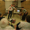 98/05/21 Computer Lesson - James Neiss Photo -  Area senior citizens had a chance to see what the high schoolers are doing with their computers. Here they are given a Midi Music demonstration.