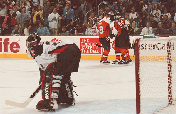 5/11/97--SABERS/PENALTY SHOT--DAN CAPPELLAZZO PHOTO--SABRES GOALTENDER STEVE SHIELDS STANDS DEJECTED AS THE FLYERS CELEBRATE ERIC LINDROSS' PENALTY SHOT GOAL IN THE SECOND PERIOD.<br /> <br /> SP