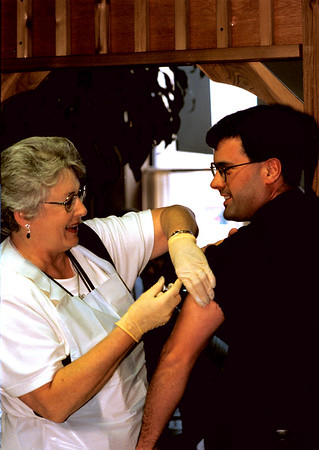 98/11/06 Cop gets Flu Shot *Dennis Stierer Photo -<br />  Lockport Patrolman Paul Beakman gets his annual Flu Shot from Donnal Moyer, Community Health Nurse with the Niagara County Health Department., which was held Friday afternoon at City Hall.