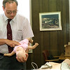 98/07/28 Medina CPR-Rachel Naber Photo-Investigator Donald Organisciak practices  CPR on an infant at city hall.