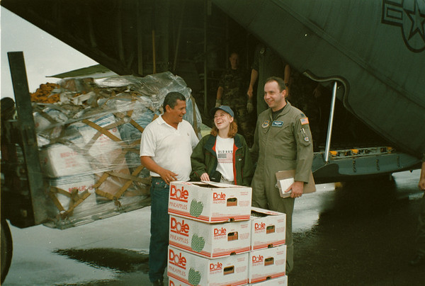 98/25/98 Honduras Relief - Tom Thering Photo - L-R - Mario LaGuardia, A Standard Fruit Company Employee laughs with Gazette Reporter Valerie E. Pillo and Capt. Chuck Giarrizzo, navigator with the 914th Airlift Wing.