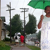 98/08/10 Bell Striker-Rachel Naber Photo-Bob Glinsboeckel a local Bell Atalntic worker for 12 years walks the picket line in the rain with fellow union members.