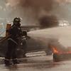 97/08/97 Truck Car Accident3 - A Shawnee Volunteer Firefighter battles a Truck fire on Nash Road.