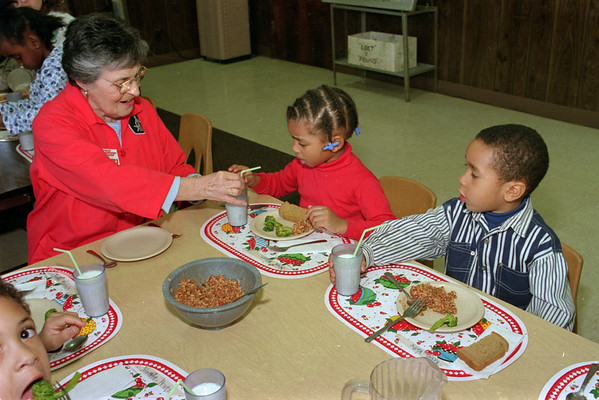 98/02/05 Lunchtime Grandma *Dennis Stierer photo - Foster Grandma  Caroline Sapia with the Headstart program helps Niya Hilson with her straw at lunch as Kevin Kelly watches.  Have no idea who is looking up at me in lower left corner!!!!!!!