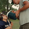 98/08/11- water from dad --Takaaki Iwabu photo-- A 7-year-old Steven Mitravich gets a water from his father Dan Mitravich during the football practice at Jayne Park on Cayuga Island Tuesday.  His team, Diamondbacks, was preparing for the up-coming football season. <br /> <br /> Grapevine photo