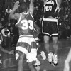 1/23/97 LaSalle VS NF 3 - James Neiss Photo - Basketball - # 50 Carlos Davis puts one up durring the 2nd qtr as #33 Mike Myles tries to block.