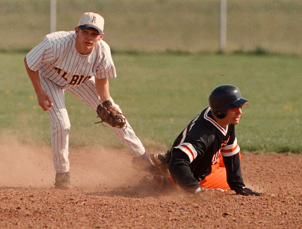 5/12/97--WILSON BASEBALL--DAN CAPPELLAZZO PHOTO--WILSONS EDDIE REDMOND STEALS SECOND SUCCESSFULLY AS ALBION S.S. B.J. AINA LOOKS UP FOR THE CALL IN 2ND INNING ACTION AT WILSON HIGH.<br /> <br /> SP