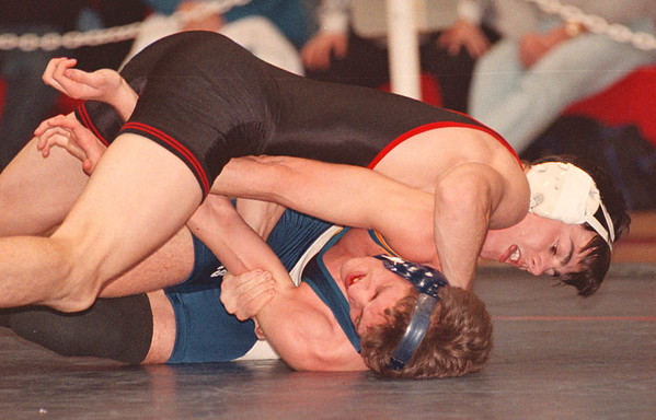 2/15/97 Wrestling Tourny - James Neiss Photo - Dan Dixon of Niagara Wheatfield gets the best of Joe Yoder of Lockport in the 119 lb class. <br /> <br /> Section 6 Class AAAA Wrestling at NT