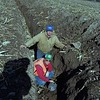 98/12/01 Old Drain   *Dennis Stierer Photo<br /> Charlie Pettit (standing) was laying new drainage pipes when he found an old one made out of sandstone, used during the quary days. David Reckahn, with the Orleans County Soil and Water Conservation District sticks the shovel's handle in the open drain. <br /> REWRITE CUTLINE HOW YOU FEEL BEST.