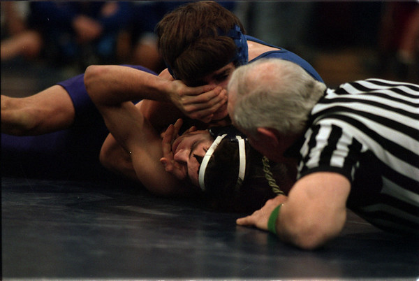 98/1/3 Nefane Wrestle-Rachel Naber Photo-Mike Craft of Newfane (top/blue suit) trys to pin Ben hamm in the 125 pound weight class at the Nefane High School wrestling tournament.
