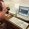 2/27/97--NU BUSINESS/COMPTIME--DAN CAPPELLAZZO PHOTO--NU BUSINESS PROFESSOR, DR. ROLAND KIDWELL, CHECKS THE UNITED STATES DEPT. OF LABOR WEB SIGHT REGUARDING THE ISSUE OF OVERTIME OR COMPTIME FOR EMPLOYEES.<br /> <br /> FEATURE
