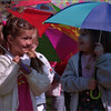 "98/04/22 Umbrella parade2-Rachel Naber Photo-Chelsie Goodrich (left) and Elizabeth Coulson go on a spring walk with classmates from the First Baptist Nursery School to learn about signs of spring and have fun with learning the letter ""U"" for umbrella."