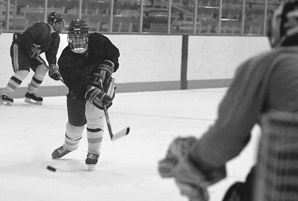 1/9/96-- NU hockey 2--Tak photo-- Goalie Greg Gardner, right, waits for the shot from a teammate during the practice.