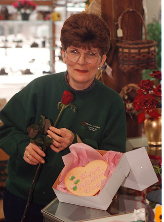 2/7/97 Flowers by JoAnne - James Neiss Photo - Jo Anne Lotterio, owner, shows off a flower cookie combo for Valentines day... Only $10.00... check price again.
