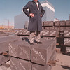 3/24/97 Jesse Sabin - James Neiss Photo -Jesse Sabin,  Site Manager of SGL Carbon Group,  Niagara Falls facility, stands on top of Carbon Graphite Blocks used in the production of Semi conductors. The plant is expanding it's facility with the building in the background.<br /> <br /> Carbon Graphite, Great Lakes Carbon, Business, Outlook 97