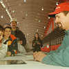 98/03/14-- speed zone --Takaaki Iwabu photo-- Stephen Lagamba, left, 7-year-old from Niagara Falls, gets an autograph from Kyle Petty at Speed Zone '98 at Niagara Falls Convention and Civic Center Saturday. <br /> <br /> sports, Sunday, bw with promo