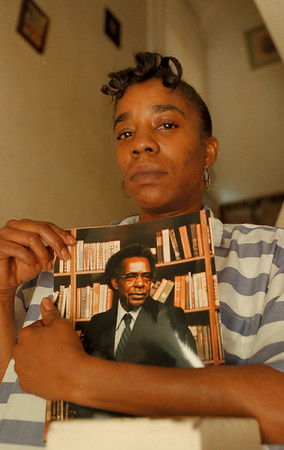 98/08/12--Unsolved Murder 1-Takaaki Iwabu photo-- Hazel Graham of Pierce Ave. in Niagara Falls holds her father William GrahamÕs photograph. Her father was killed about a year ago and the murder case is still remained unsolved. <br /> <br /> Sunday, 1A, color