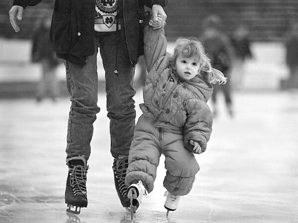1/2/97 first stating--Takaaki Iwabu photo-- Sara Diletti, 3, Niagara Falls, holds tight her mother Jeri's hands at Marine Midland Centennial Ice Rink Thursday as she tires her new skating shoes that she got as a Christmas gift. (and this was her first-ever skating. There were fewer skaters in Plaza because of the rainy weather)        Grapevine photo