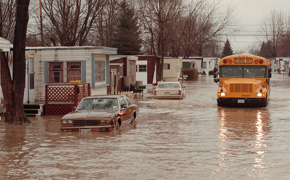 98/01/12--flooding B&W--dan cappellazzo An evacuation school bus cruises through cayuga picking up stranded residents.<br /> <br /> echo