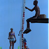 """98/08/04 County Fair - James Neiss Photo - Jenna Rae of Virginia and Ron Weisbeck of Buffalo both were cleaning and preping the """"Sky Master"""" ride for opening day at the Niagara County Fair. Both work for Amusments of Buffalo."""