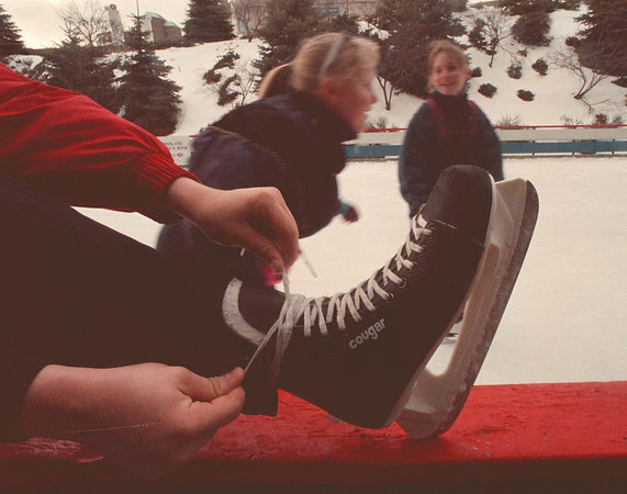 2/15/97 Scate Day - James Neiss Photo - Ice Scaters enjoy the cold weather at the Lackey Plaza Centenial Ice Rink.